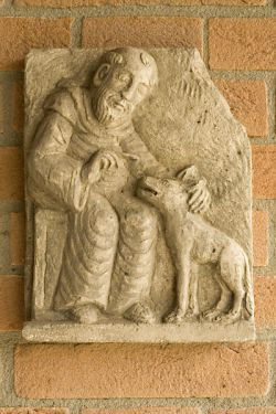 Francis of Assisi and the wolf, stone carving